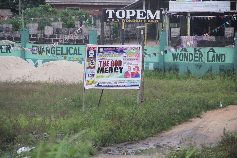 (Wonder land and other religious signs on the streets of Lagos)