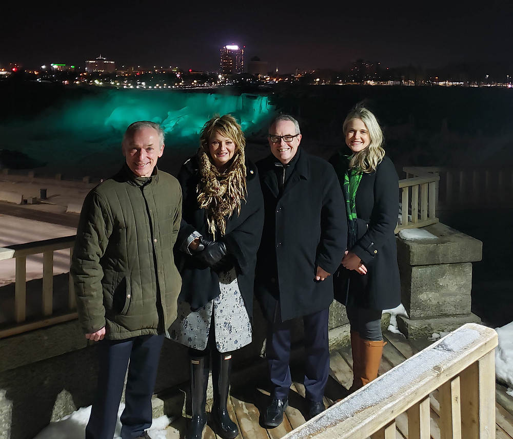 Minister Richard Bruton; Sandie Bellows, Niagara Parks; HE Jim Kelly, Ambassador of Ireland to Canada; and Dana Welch, Tourism Ireland, at the 'greened' Niagara Falls.
