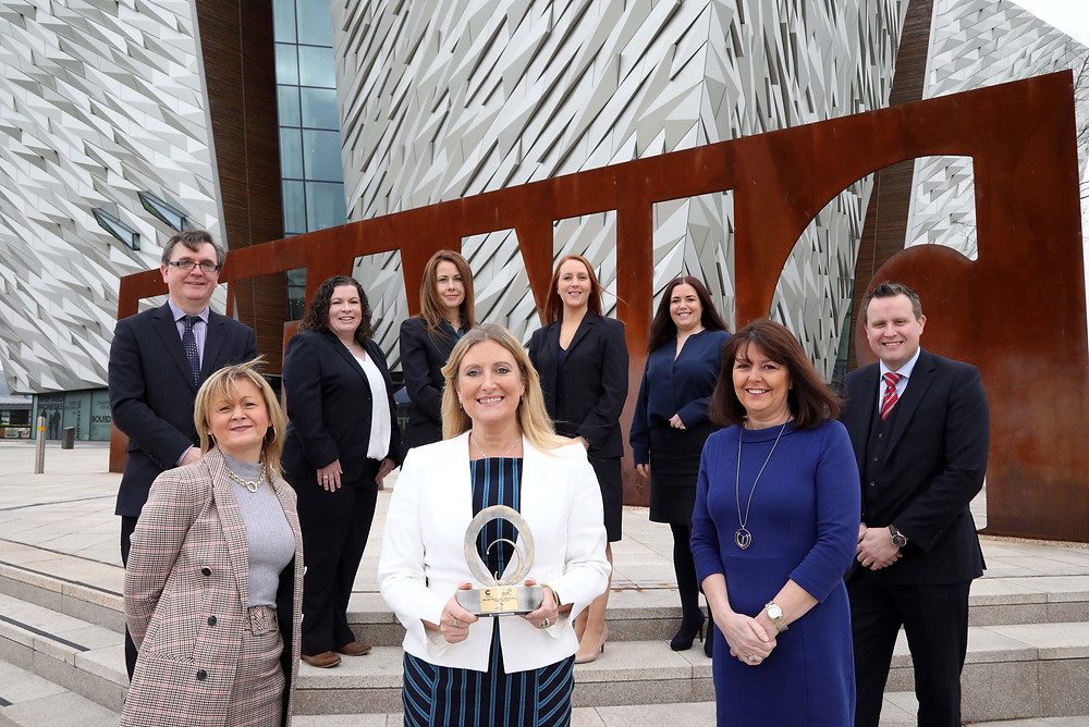 TBL International Directors, Judith Owens, Siobhan Lynch and Michele Scott celebrate the EFQM Excellence Ireland Award with Titanic Belfast's Senior Executive Team.