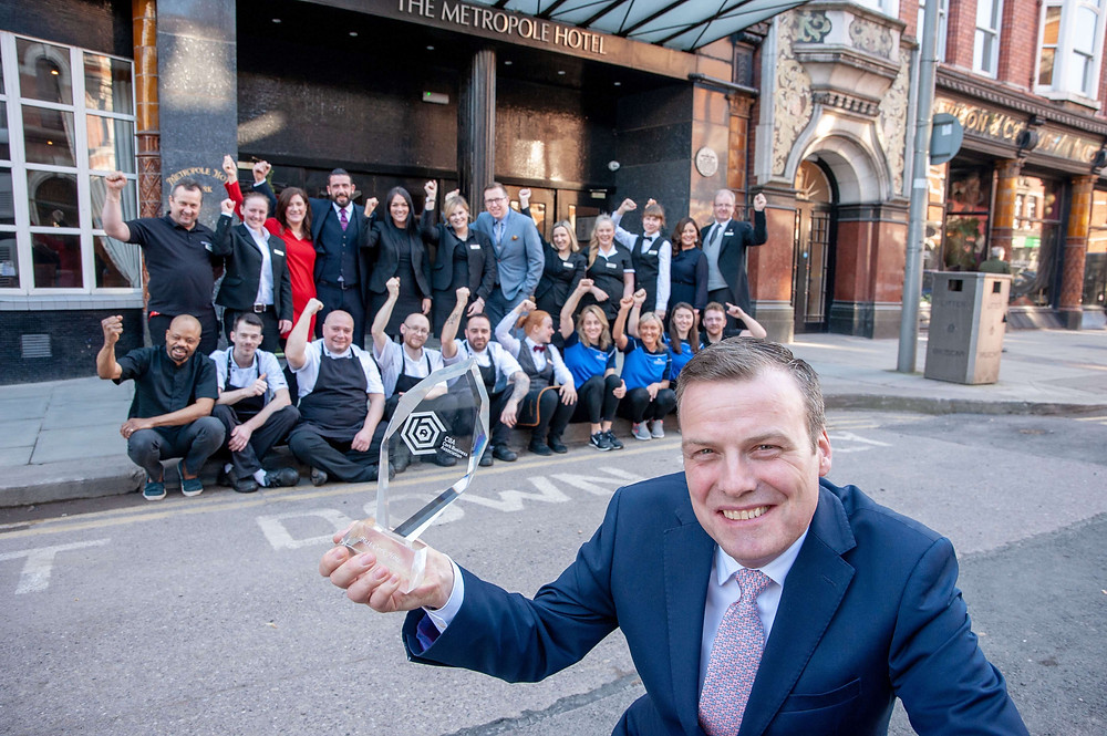 Metropole Hotel General Manager Roger Russell and team
