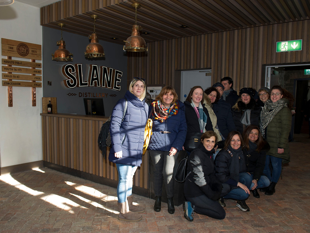Italian travel agents with Mary O'Connor, Tourism Ireland (standing, third left), at Slane Distillery.
