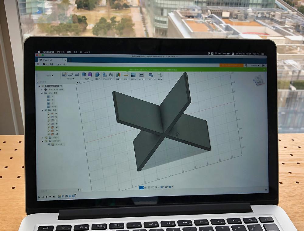 3D model shown on MacBook Pro
