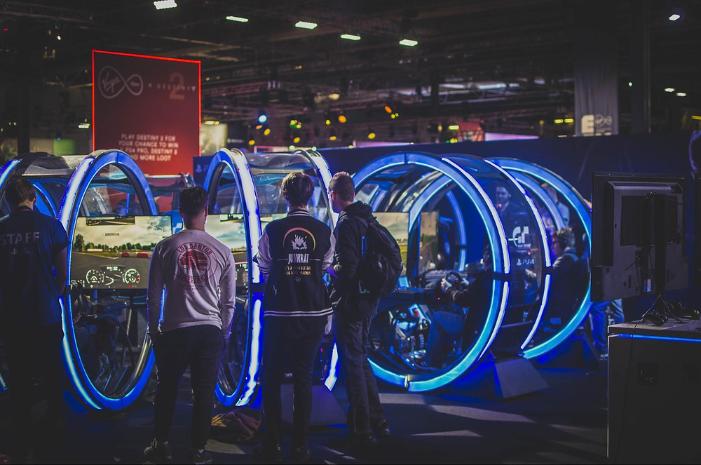 Racing car simulators at exhibition - photo by Jamie McInall via Pexels