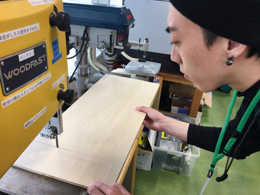 Japanese man using wood cutting machine, Tokyo, Japan