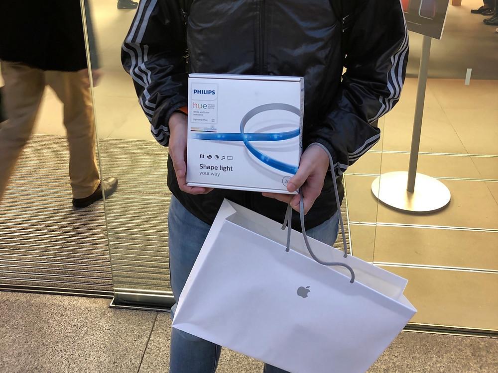 Man holding Philips Hue HomeKit box at Apple Store Ginza, Tokyo, Japan