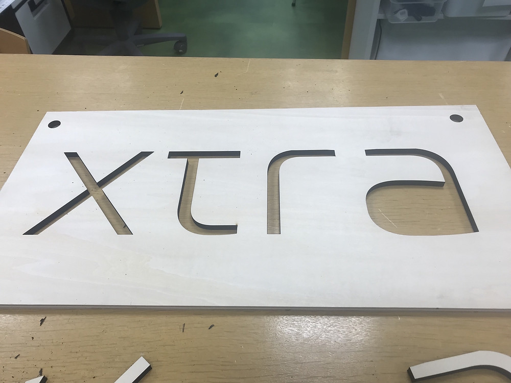 Logo cut out of wood, Tokyo, Japan