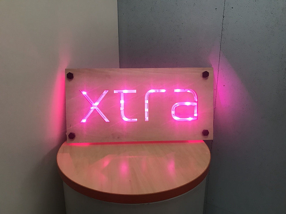 Illuminated Xtra, Inc. corporate logo laser-cut from wood, Tokyo, Japan