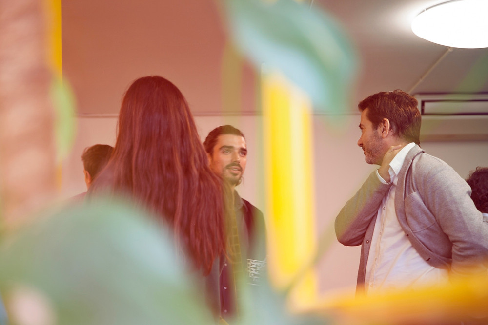 People talking at a networking event.