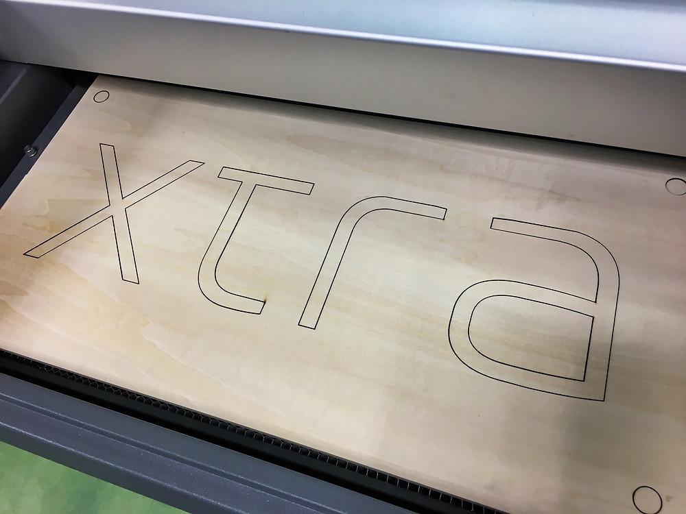 Laser cutting logo from wood, Tokyo, Japan