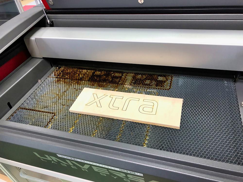 Testing laser cutter on logo, Tokyo, Japan