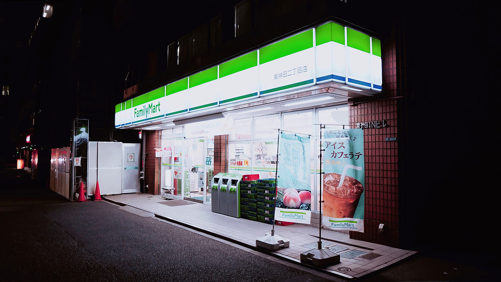 FamilyMart convenience store at night in Japan.