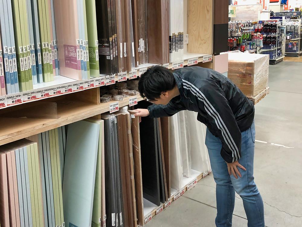 Japanese man searching hardware store, Tokyo, Japan