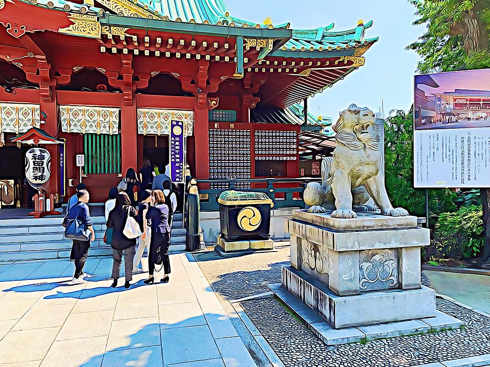 Komainu (lion dog) statue guarding the main pavilion of Kanda Shrine, Chiyoda, Tokyo, Japan