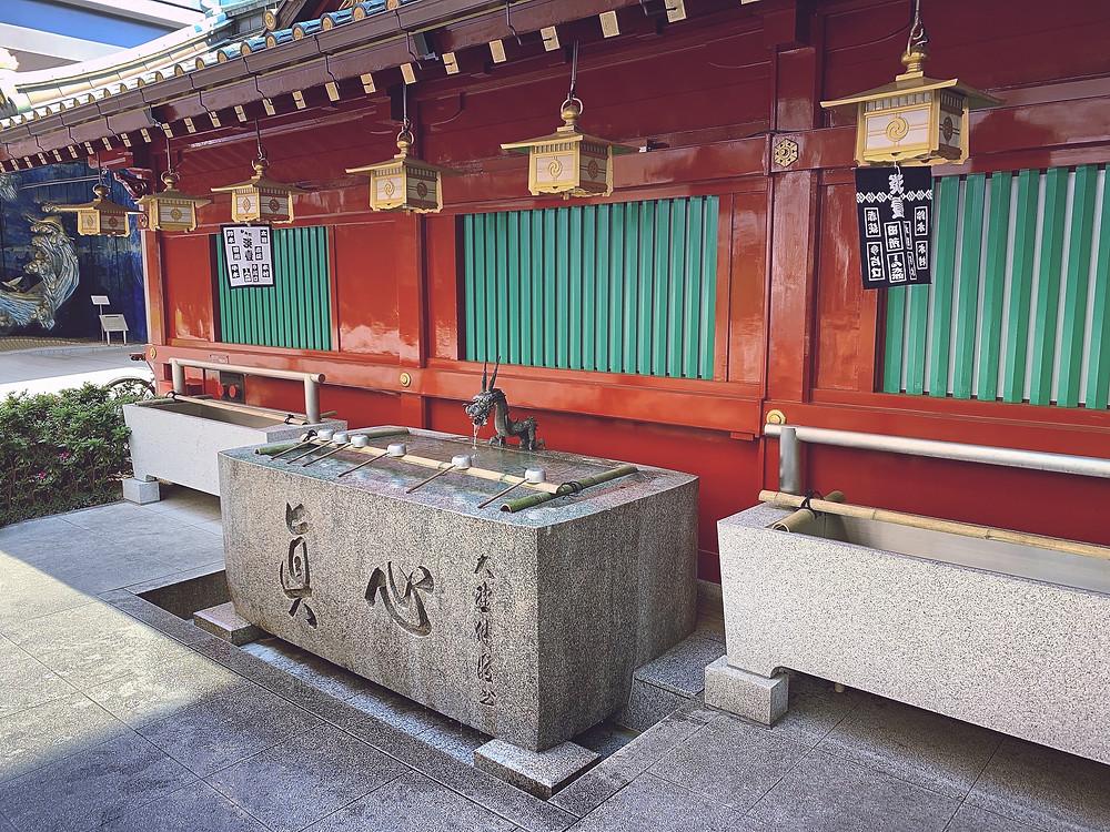 Water for hand washing at main gate of Kanda Shrine, Chiyoda, Tokyo, Japan