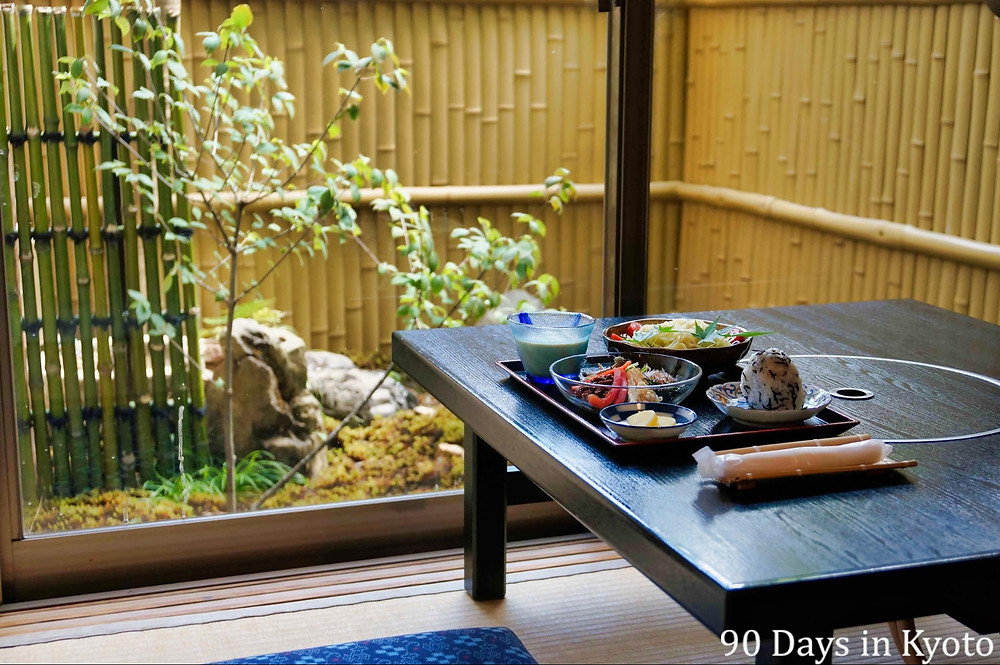 Traditional Japanese meal served by garden, Kyoto, Japan