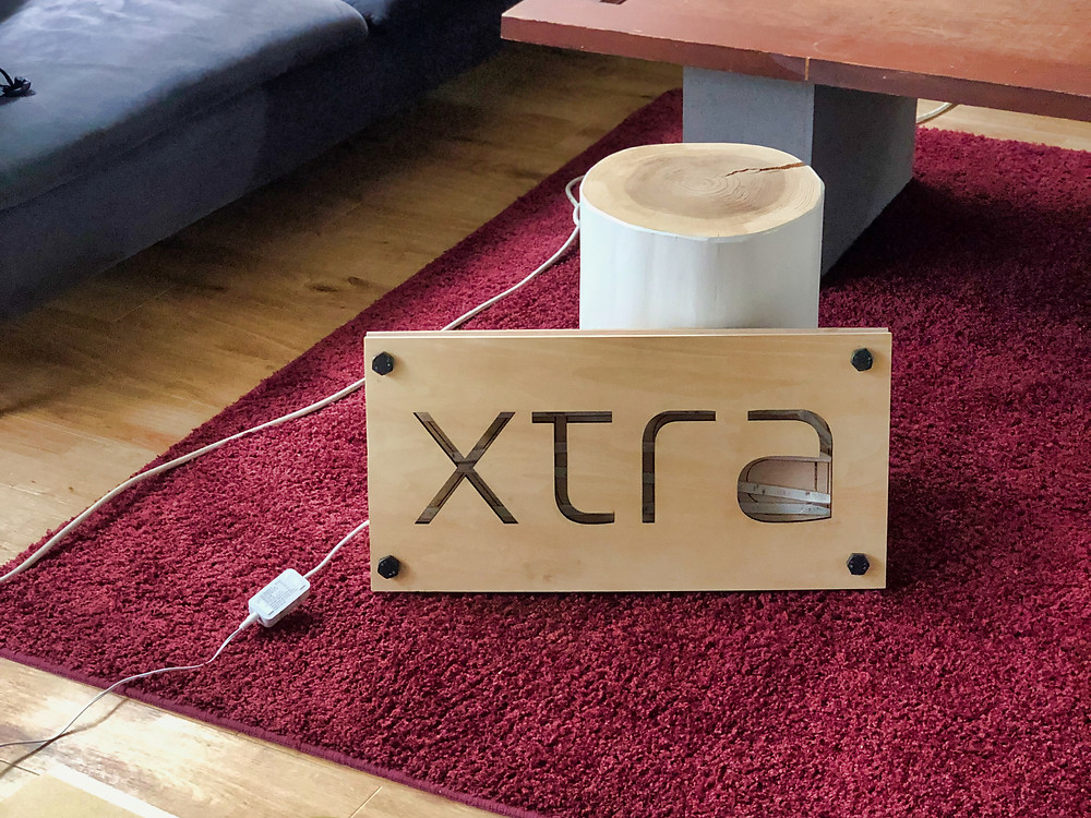 Xtra, Inc. corporate logo laser-cut from wood, Tokyo, Japan