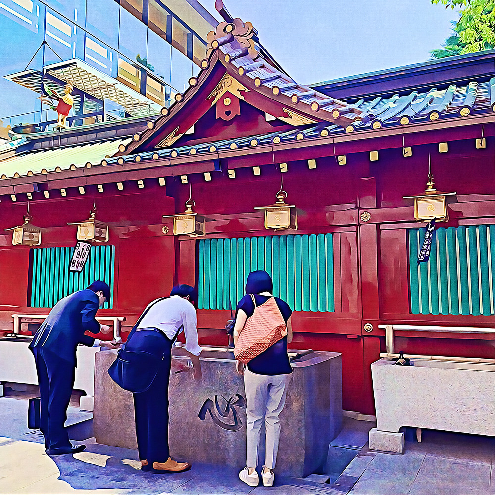 People washing hands at main gate of Kanda Shrine, Chiyoda, Tokyo, Japan