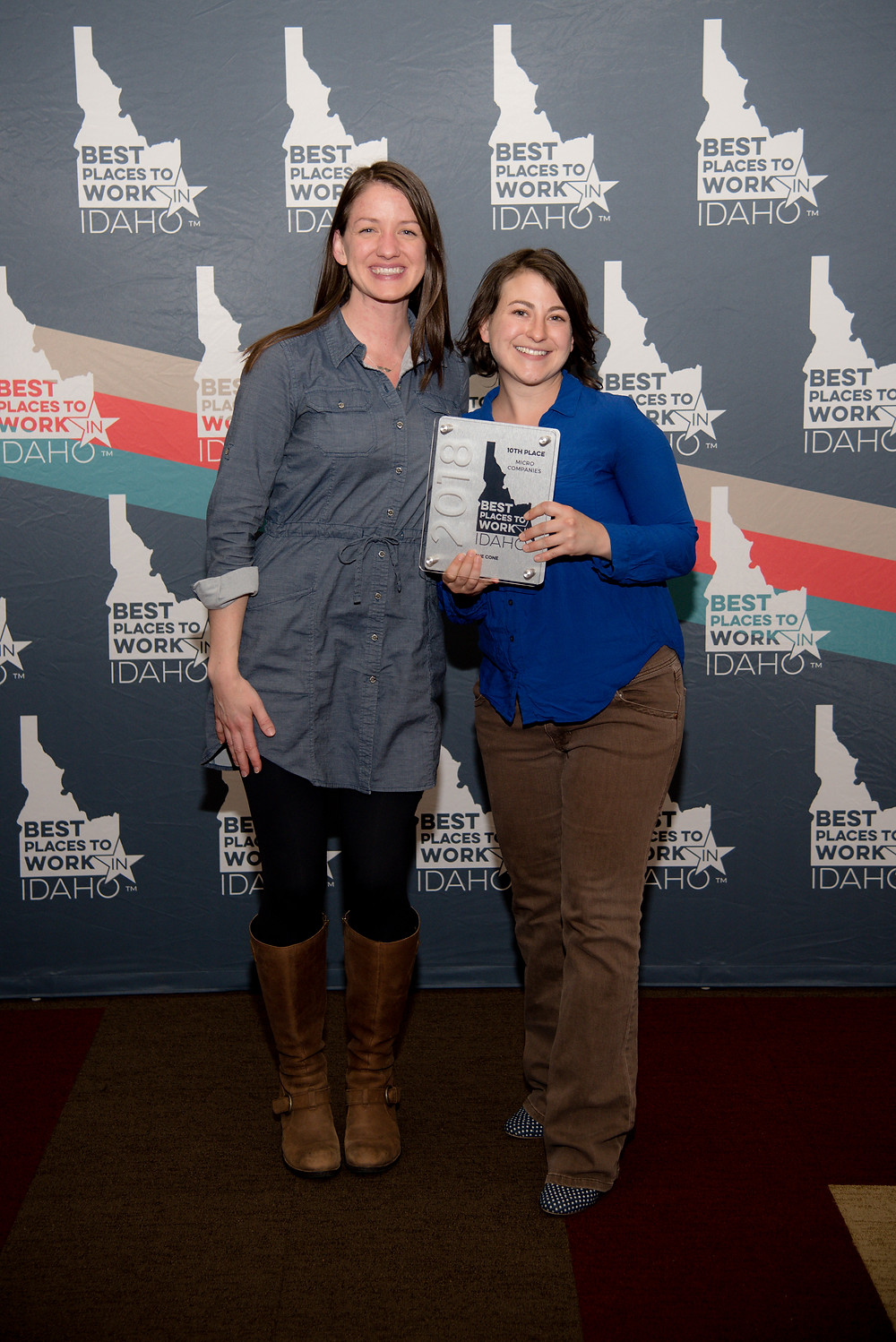Karen and Jess accept the 2018 Top 10 Places to Work in Idaho Award on behalf of LONE CONE.