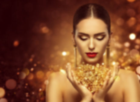 Fashion Model Holding Gold Jewelry in Ha