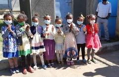 Children with masks 2.jpg