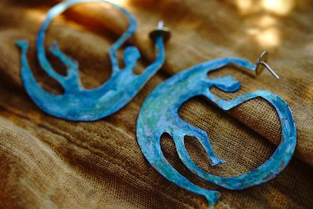 Human rust earrings