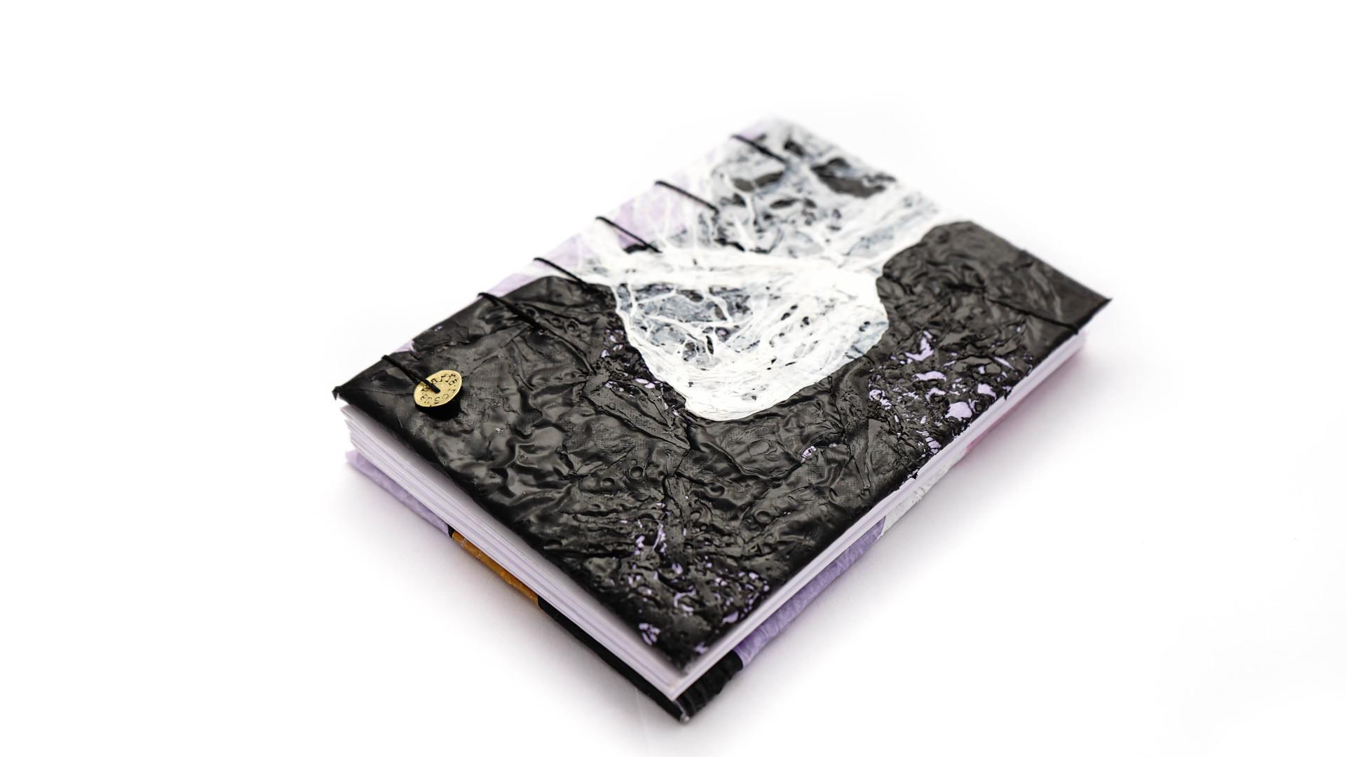 Cuadernos de plastico reciclados