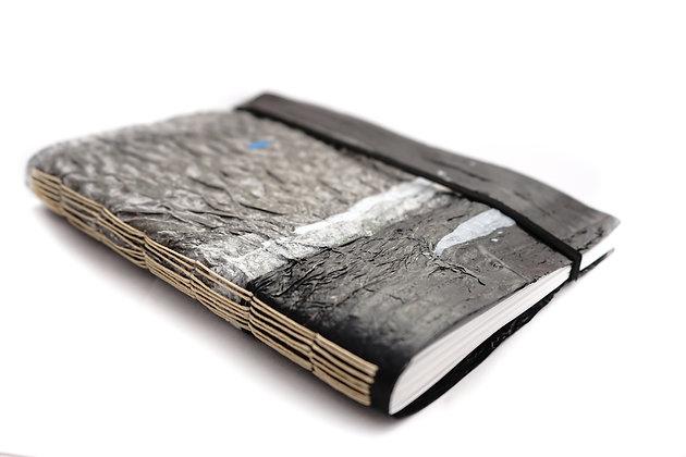 Cuaderno con tapa de plástico reciclado