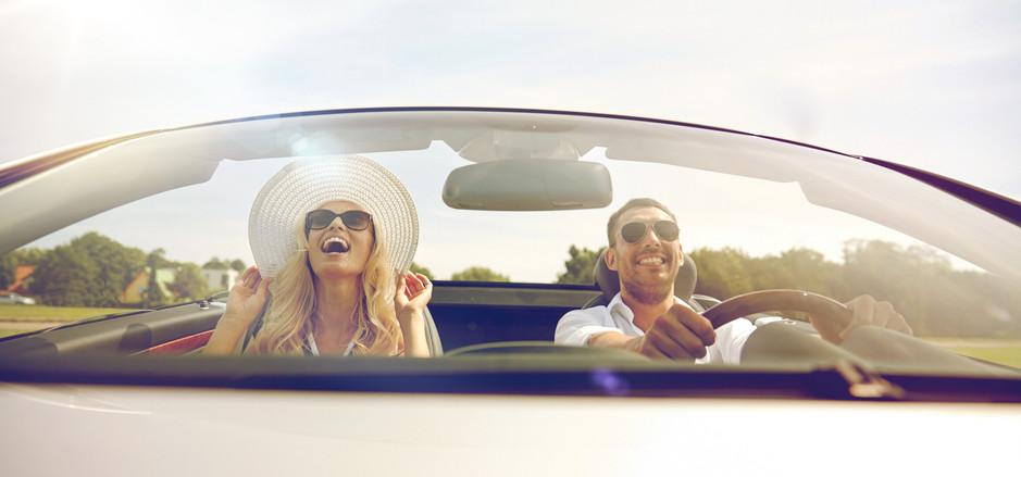 happy honeymoon couple in convertible car