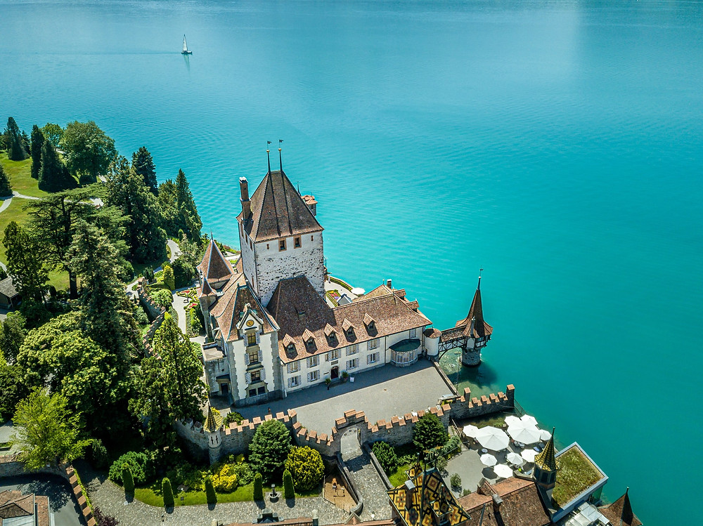 Oberhofen Castle at Lake Thun fly over view