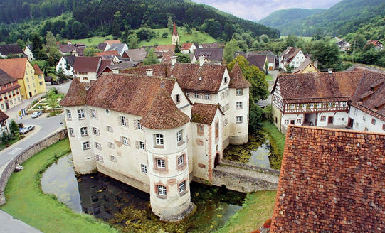 Castle sourrounded by water in the Black Forest Germany