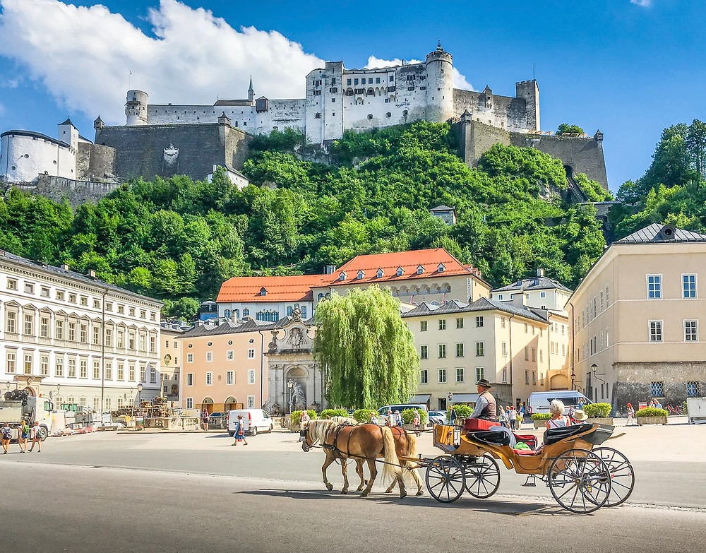 horse carriage on square before Salzburg fortress