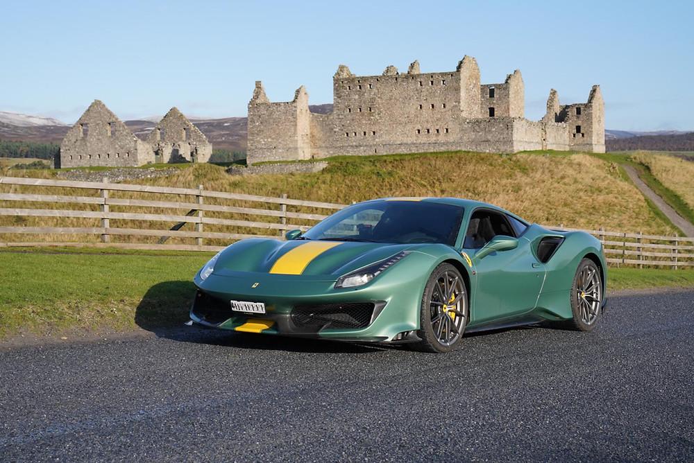 Ferrari parked before Ruthven Barracks in Scotland