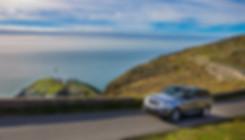 Range Rover driving on scenic coastal road