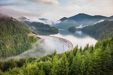 Vidraru dam in Romania surrounded by clouds