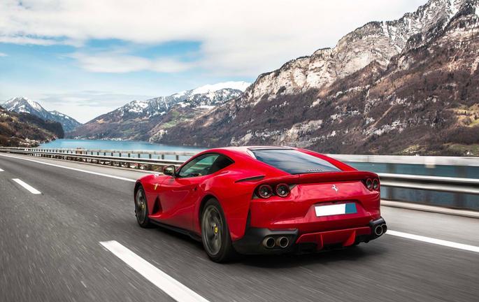 Ferrari driving in the Swiss Alps