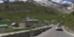 Porsche 911 driving on Stelvio Pass