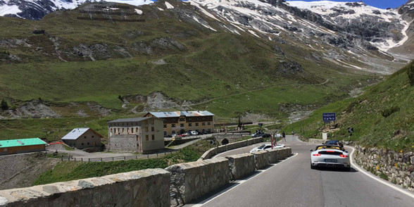 Porsche driving on Stelvio Pass in Italy