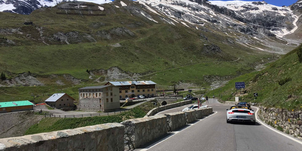 Porsche driving on Stelvio Pass in Italy