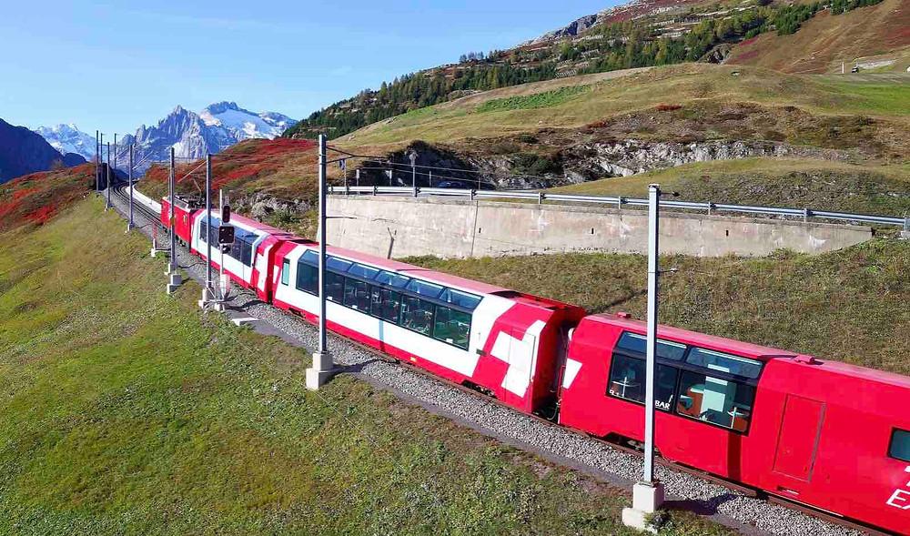 Glacier Express train heading through the Swiss Alps