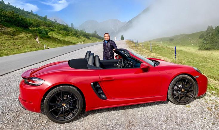Men photographed next to Porsche on honeymoon trip