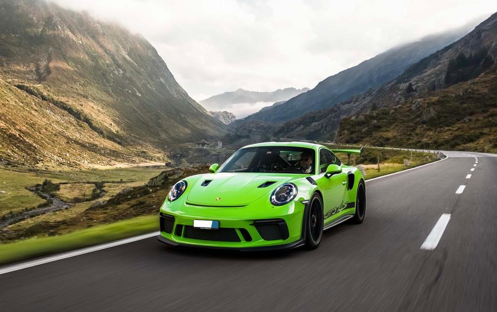 Porsche GT3 driving on Swiss Mountain Road