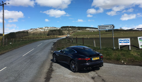 Jaguar F Type parked at side of Old Militaty Road in Cairngorms National Park