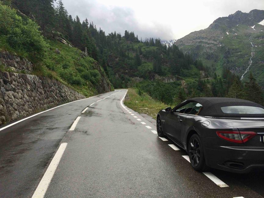 Maserati parked on roadside of Susten Pass