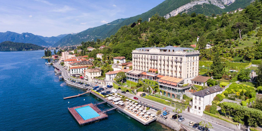 Floating pool and Grandhotel Tremezzo at Lake Como in Italy bird eye view