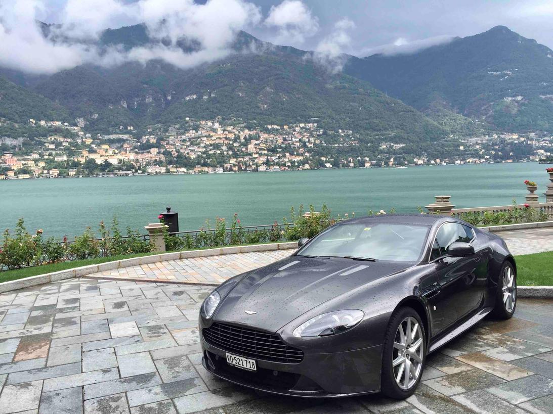 Aston Martin parked with lake Como behind