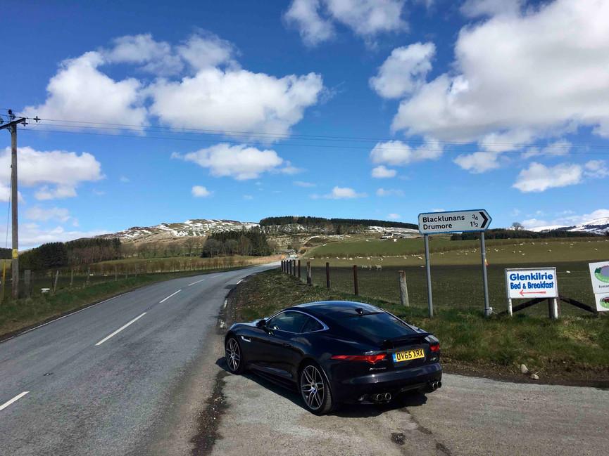 Jaguar F Type parked on roadside of NC500