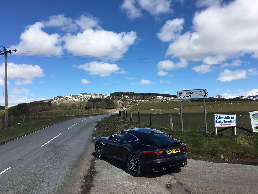 Jaguar F-Type parked on Snow Road in Cairngorm National Park