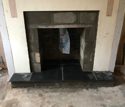 Fireplace built in and hearth laid