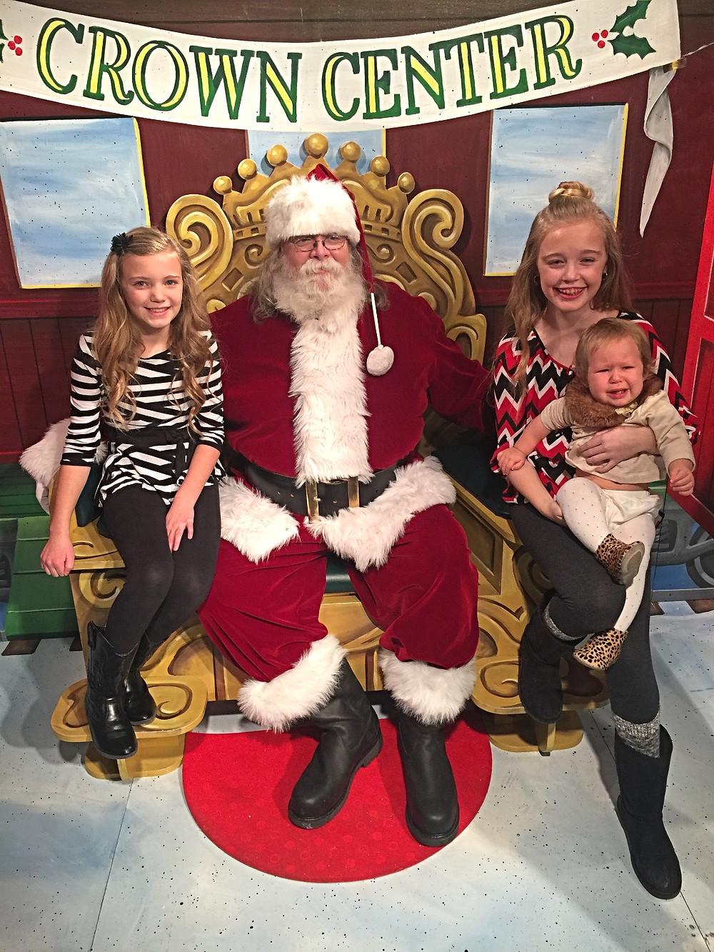 My girls and niece visiting Santa.