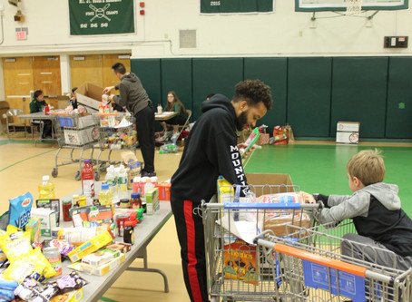 MSJ students, alumni, staff and volunteers help more than 100 families in need
